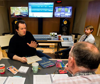 Maestro Nelsons listens during a playback session with Squire and William I. Bernell Artistic Administrator and Director of Tanglewood Anthony Fogg.