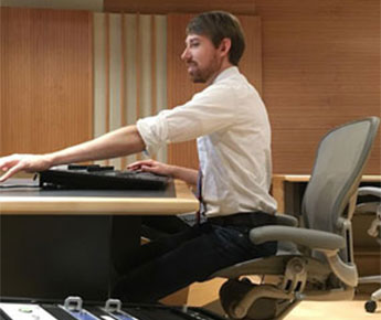 Recording Engineer Nick Squire sits in the BSO's new recording studio.