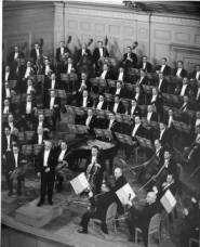 Serge Koussevitzky and BSO on the stage of Symphony Hall, ca. 1940. Photographer unknown, courtesy BSO Archives